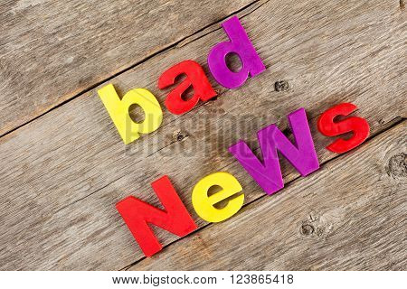Colored letter magnets spelling text BAD NEWS