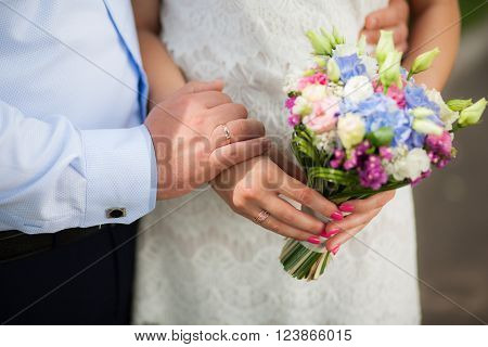 Wedding Bouquet Of Flowers In Hands Of Beautiful Anonymous Young Bride