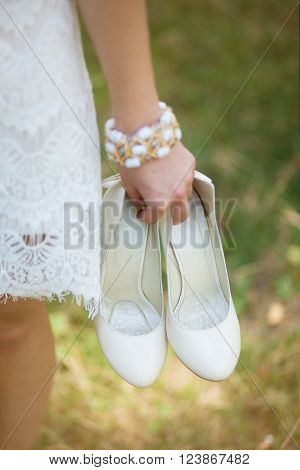Barefoot Young Girl Wearing White Beautiful Dress Holding Shoes