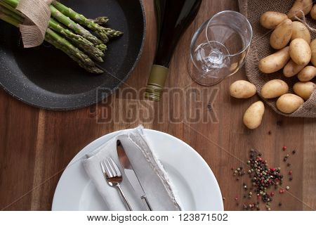 Fresh green asparagus with potatoes and place setting