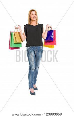 Joyful shopping woman holding shopping bags on white background