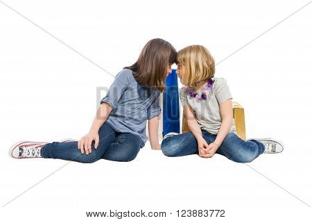 Young shopping sisters or daughters looking at each other isolated on white background