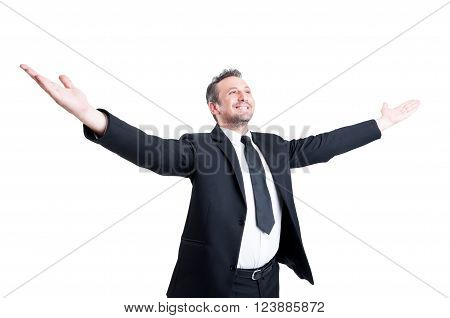 Very Successful Business Man Stretching Arms Wide Open