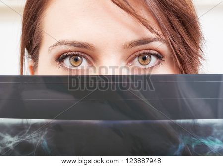 Beautiful Female Doctor Eyes Above X-ray