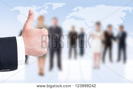 Business man hand showing like or thumbup on business people background