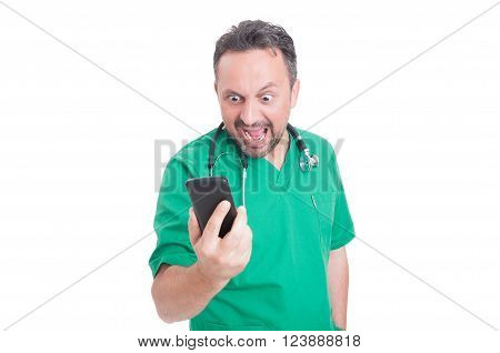 Angry Doctor Looking And Yelling At His Smartphone