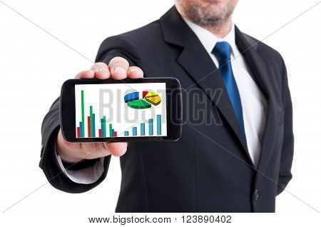 Marketing manager holding smartphone with growing financial chart and piechart isolated on white