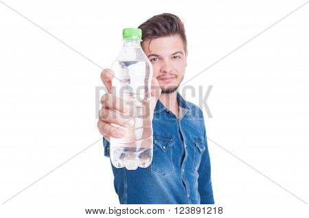 Man showing plastic bottle with cold water to the camera isolated on white studio background