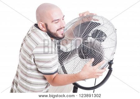 Sweaty And Heated Man Hugging Blowing Fan Or Cooler