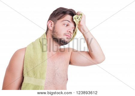 Naked man wiping forehead after refreshing shower in sumer heat season