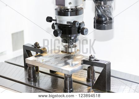 operator use graphite EDM electrod to make precision mold and die poster