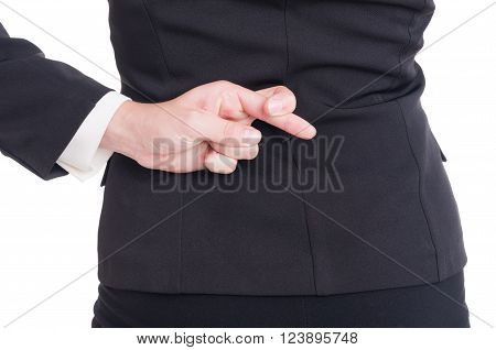 Close-up with good luck or fake promiss gesture behind back made by business woman or lawyer on white background poster