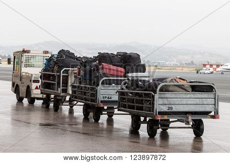 Luggage Cart On The Runway Of The Airport Macedonia A Rainy Day