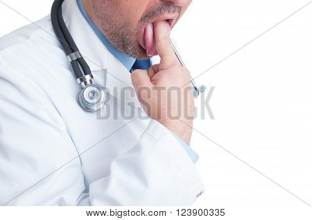 Medic Or Doctor Inserting Finger Into Mouth To Vomit