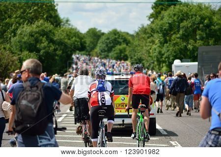 PAMPISFORD, CAMBRIDGESHIRE, UK - JULY 7 2014 Tour de France 2014 Stage 3 (Cambridge to London) with police car and spectators following peloton