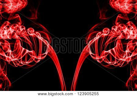 abstract red smoke on black background with copy space, texture of smoke
