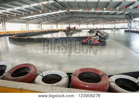 CHIANG MAI, THAILAND - MARCH 26: People drive indoor drifter go-cart at X centre which is the one-stop for all adrenaline junkies with a wide range of thrilling activites in Chiang Mai, Thailand on March 26, 2016.