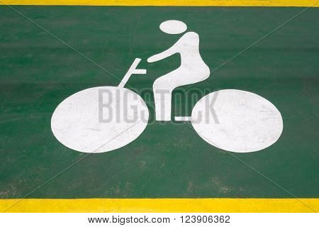Bicycle symbol on green road for bicycle lane. Bicycle sign to indicate bike lane increasing traffic safety.