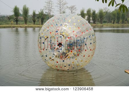 People Play Zorb Inflatable Ball On The Pond
