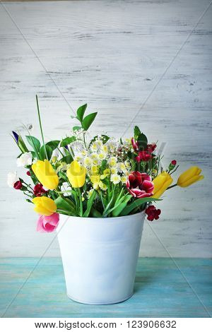 Bouquet of fresh flowers in a vase on white table