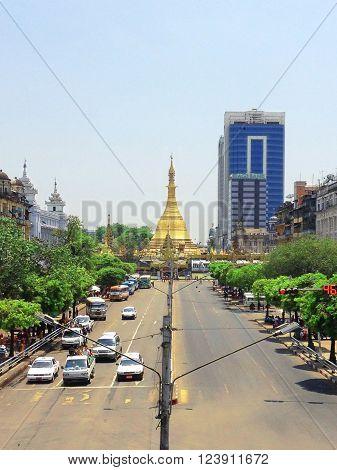 YANGON. MYANMAR - April 15, 2013: View of Sule pagoda from Sule Paya Road. Sule paya located in Yangon's downtown.