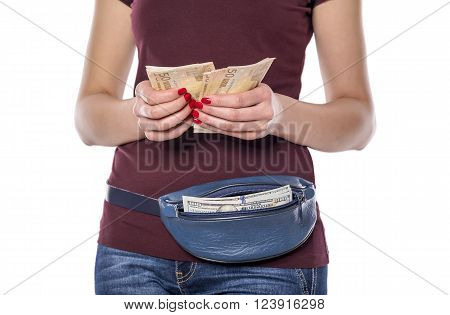 Female hands counts the money. Silhouette of a woman with a purse on a white background.