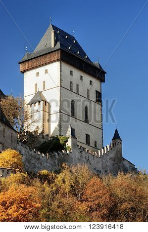 Autumn view of the castle Karlstejn in the sunlight