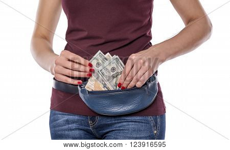 Wallet with money on a woman's waist. On a white background.