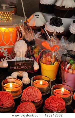 Cookies marzipan on a table with a variety of sweets in honor of Halloween