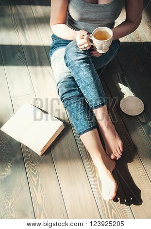 Cozy Photo Of Young Woman With Cup Of Tea Sitting On The Floor