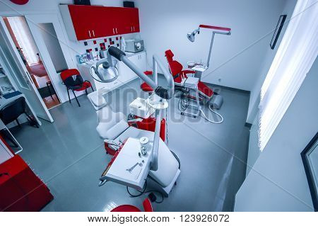Interior of dental clinic with dental chair dental tools and dental lighting equipment BLUE TONE