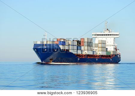 Loaded large container ship sailing in the sea
