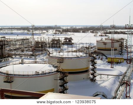 Russia, Nefteyugansk - 20 January 2012: Oil field. The equipment of crafts in Western Siberia iron designs and pipes