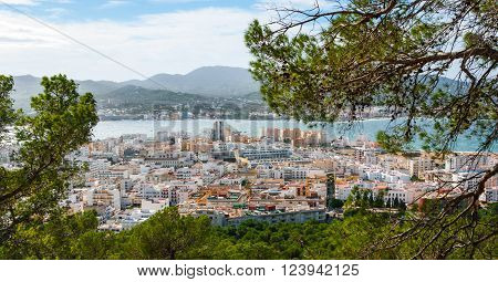 High, hill side view of St Antoni de Portmany & surrounding area in Ibiza.  Clearing November day, kindly warm breeze in autumn,  Balearic Islands, Spain.