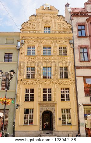 TORUN POLAND - JULY 7 2009: The house under the star a building styled with baroque ornaments on 35 Rynek Staromiejski at the old town square