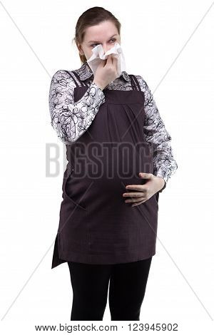 Pregnant young woman with runny nose on white background