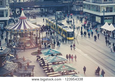 Berlin, Germany - march 30, 2016: People and trains at Alexanderplatz in berlin, germany from high viewpoint.