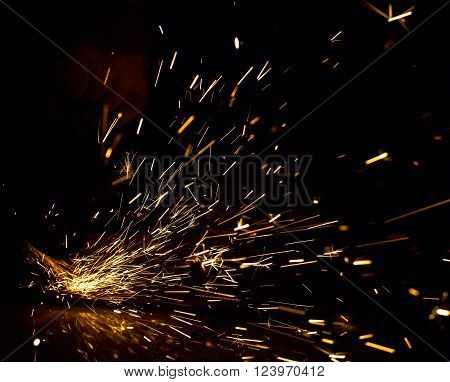 Sparks in the dark from a working grinding machine