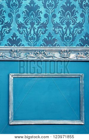 Blue vintage wall with rococo pattern and vintage toning