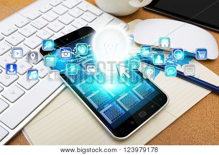 Modern Mobile Phone With Lightbulb And Digital Icons