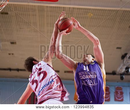 SAMARA RUSSIA - NOVEMBER 06, 2013: BC Krasnye Krylia center Artem Zabelin (35) blocks a shot attempt during the BC Royal Hali Gaziantep basketball game on November 06 2013 in Samara Russia.