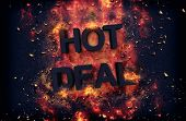 Burning orange fiery flames and explosive sparks on a dark background with the word - HOT DEAL - in black text for a dramatic poster design poster