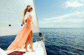 luxury woman pareo yachting boat trip in sea with blue sky sunlight poster