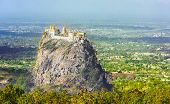 Famous buddhist temple on the summit of Taung Kalat volcano near Mt. Popa. 777 stairs have to be climbed barefoot along with monkeys to reach the top, end of pilgrimage. Myanmar poster