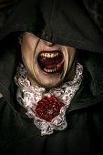Bloodthirsty vampire grins. Halloween. poster