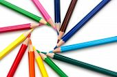 A circle of color pencils on white background poster
