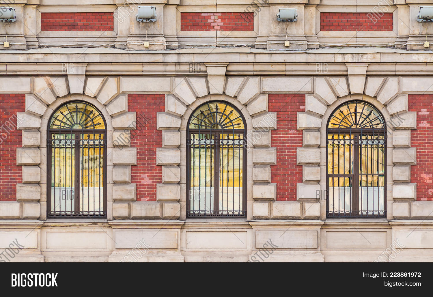 Three Windows In A Row On The Facade Of Urban Historic Building Front View