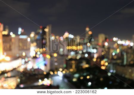 Abstract Background From Blurred Business City Center Light  From Office Building Downtown At Night