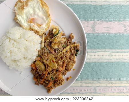 Fried Minced Pork With Tomato Chili Dip And Vegetable In White Plate With Rice And Fried Egg And Tom