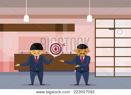Two Asian Business Men Holding Target With Arrow In Center In Modern Office Businessmen Cooperation And Achievement Concept Flat Vector Illustration